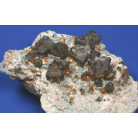Helvite on Orthoclase with Spessartine Garnet and Muscovite