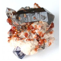 Spessartite, Fluorite, and Smoky Quartz on Albite