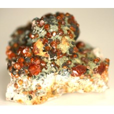 Helvite with Spessartine Garnet and Muscovite